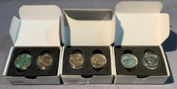 Three boxed sets of Danbury Mint Presidential dollars,