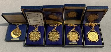 Five Crown of Crown gold plated coin pendants (boxed)
