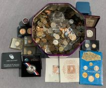 A large tin of world coins