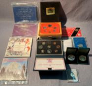 A collection of packaged coins including a Royal Mint UK Proof Coin Collection 1984,