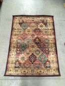 A Gabiro 208 red patterned rug - 120cm x