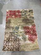 A Floral patterned design rug in beige/r