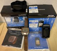 2 x Garmin units - a Garmin Forerunner 310XT multisport/triathlon watch and a Garmin Edge 705
