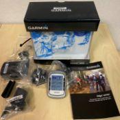 A Garmin Edge 500 cycling computer c/w heart rate monitor,