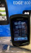 A Garmin Edge 800 touchscreen GPS-enabled cycle computer (blue rear to unit) c/w Garmin heart rate