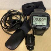 A Garmin 910XT multisport/triathlon watch, heart rate monitor,