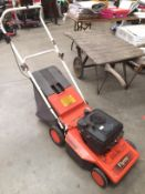 A Flymo Chevron 420GL Roller petrol lawnmower complete with collection box
