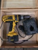 A DeWalt DW981 12v cordless drill complete with battery and charger in non-matching wood box