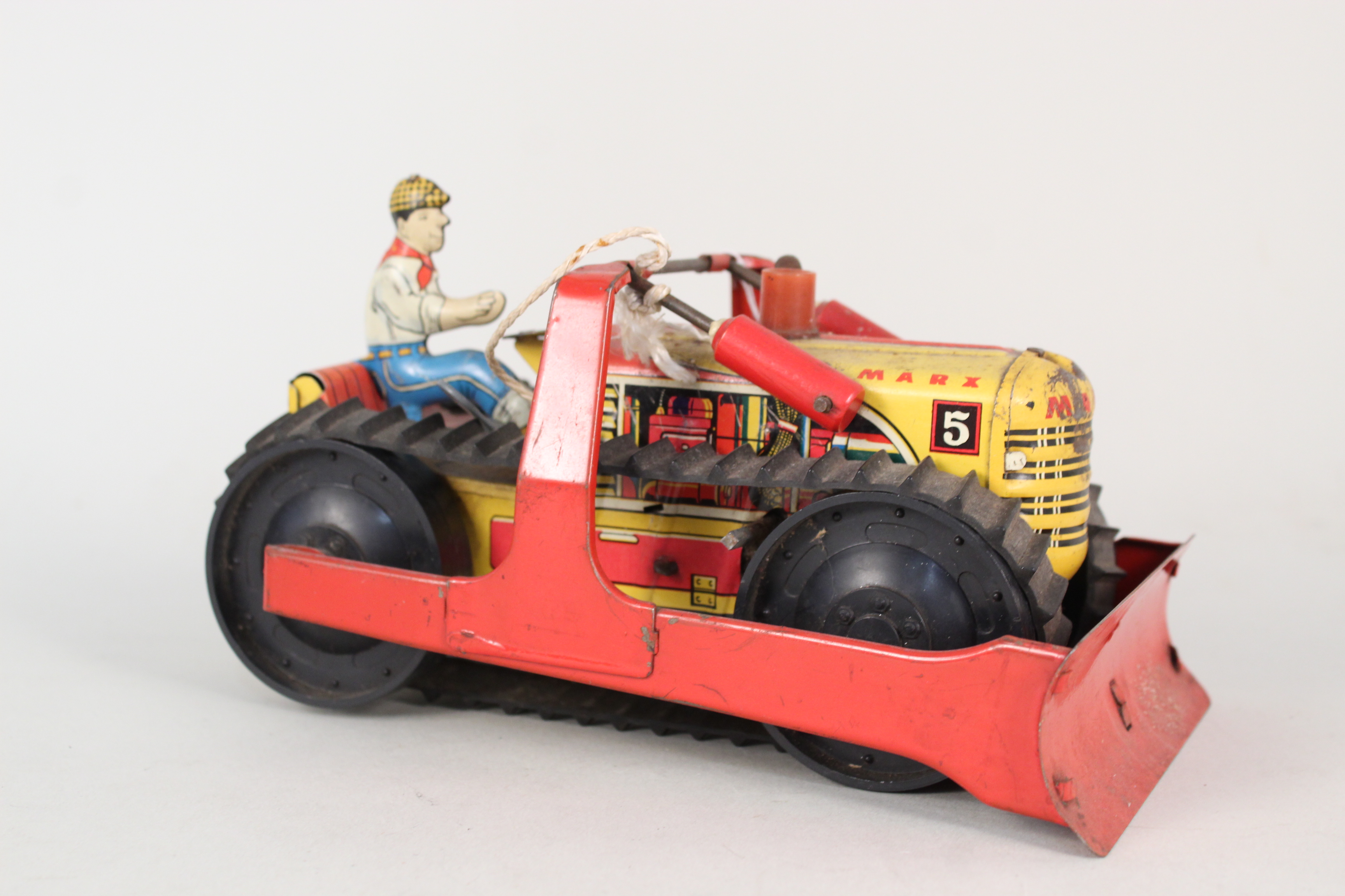 Lot 101 - A Marx tin plate bulldozer with key