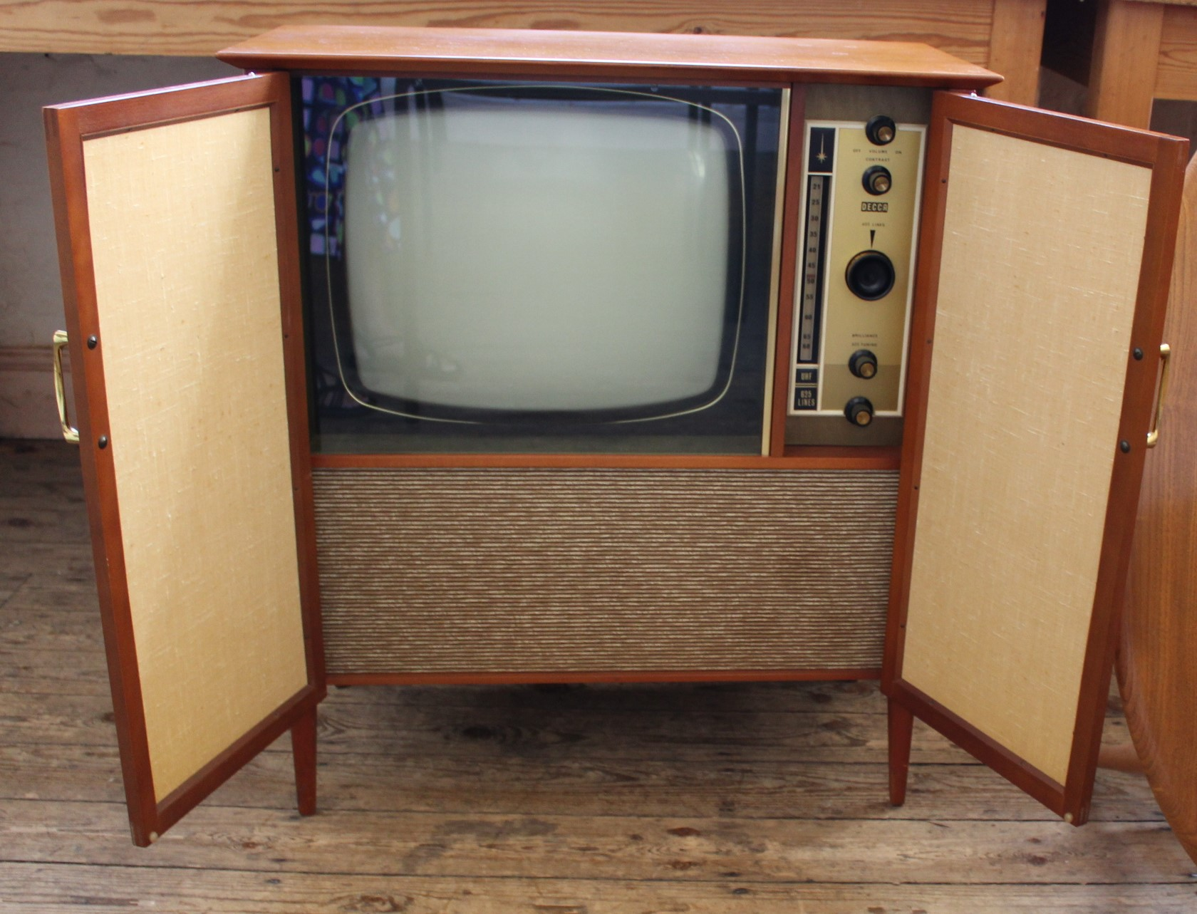 Lot 810 - A vintage Decca TV in striking stylish cabinet.