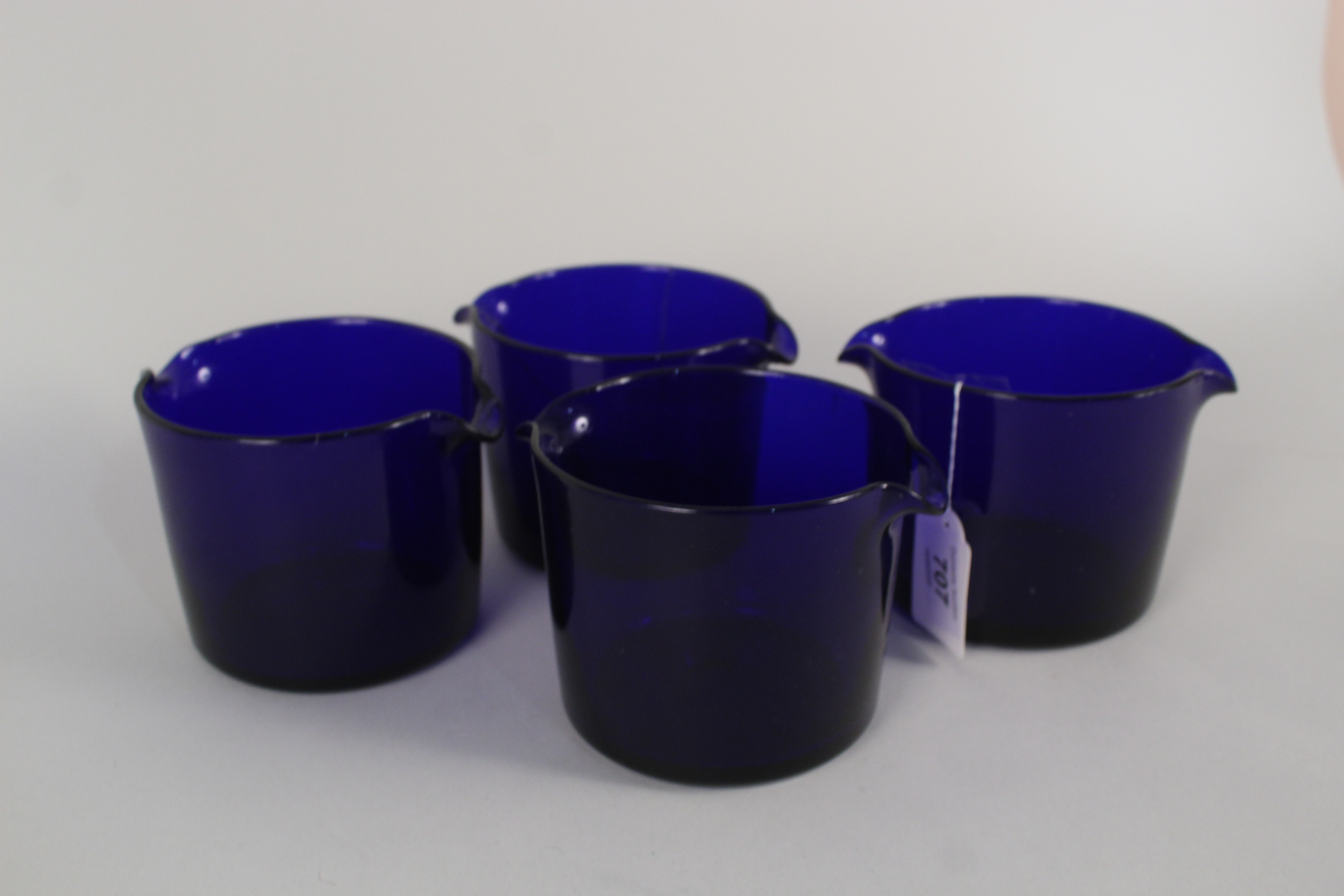 Lot 707 - Four early 19th Century Bristol blue drinking glass rinsers/coolers,