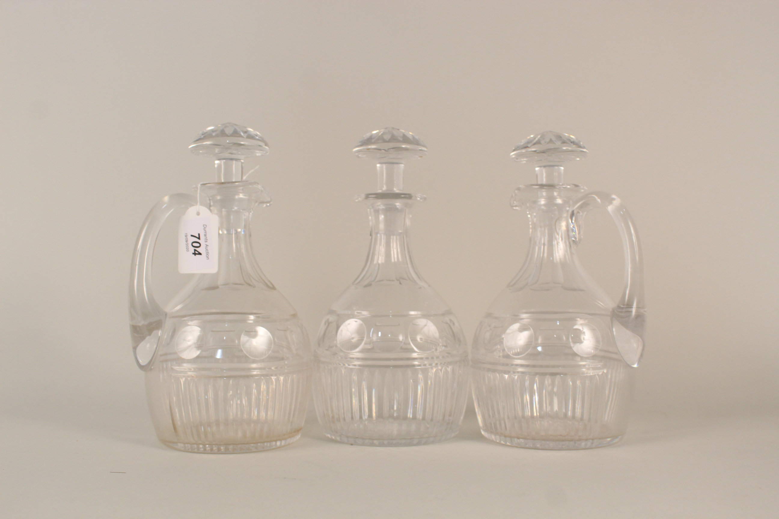 Lot 704 - A pair of Victorian cut crystal glass claret jugs with matching decanter