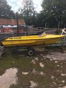 Fibre glass boat shell and trailer. Stored near Beccles, Suffolk. No VAT on this item.