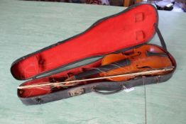 An antique violin in case (distressed and unstrung)