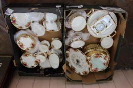 An extensive collection of Royal Albert Country Rose dinner and tea wares (two trays) including a