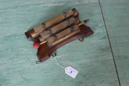 An antique set of brass three bar chimes,
