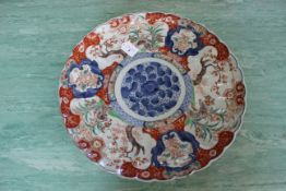 A late 19th Century Imari decorated Chinese charger,