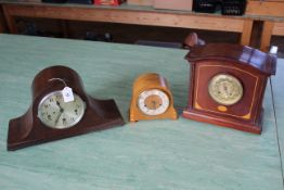 Three wooden cased mantel clocks, including an inlaid example with brass face, chiming with key,
