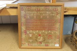 A framed sampler with central verse and decorative border by Elizabeth Rauce,