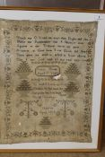 A large framed sampler on linen with biblical texts within a decorative border by Janet Hume ages 8
