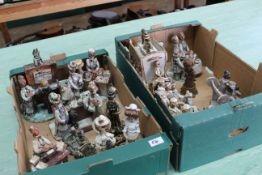A selection of pottery figural groups of a cricket team, family in the park, ladies at tea,
