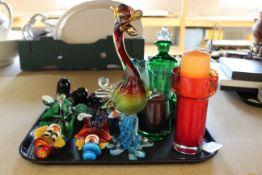 Two Murano glass clowns, a Mdina paperweight, drunken green glass decanter,