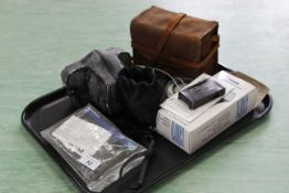 A Brownie box camera, an Olympus 35mm camera and spare 28mm lens,