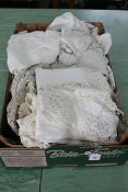 A box of mixed antique linens and lace work including a number of antique lace blouses and night