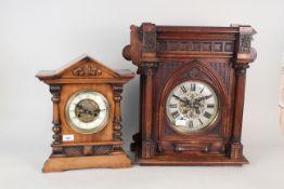 A carved oak wall clock plus a walnut mantel clock