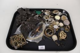 A box of assorted watch and clock spares including clock keys and carved finials