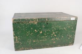 A vintage pine painted box containing assorted mantel and alarm clocks