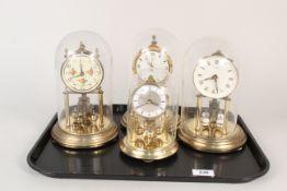 Four assorted brass dome clocks