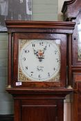 An early 19th Century oak long case clock, 30 hour duration, with square painted dial,