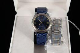 A gents Zenith Espada quartz wristwatch with deep blue dial and spare blue strap,