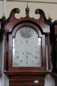 An early 19th Century mahogany and oak cased 8 day long case clock with painted arch dial,