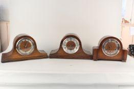 Three assorted 1950's oak mantel clocks