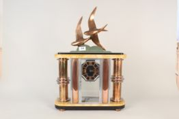 A French Art Deco marble, chrome, brass and bronze mantel clock, signed E Guy,
