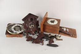 A German cuckoo clock plus two clock mounted movements (as found)