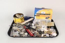 A box containing watch parts, straps, bracelets,