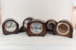 Five assorted oak cased 1950's mantel clocks
