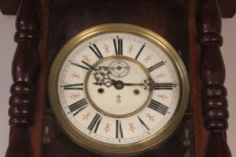 An oak and stained pine Vienna style wall clock