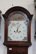 An early 19th Century mahogany arch dial cottage long case clock with painted face,