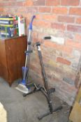 Exercise Bicycle and a Steam Mop