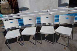Four White Plastic Chairs