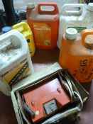 Part Used Cleaning Products and a Battery Charger