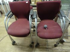 Four Upholstered Chairs on Wheels