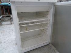 * white gram refrigerator, good condition, perfect for small kitchen.