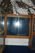 Mahogany Display Cabinet Enclosed by Sliding Doors