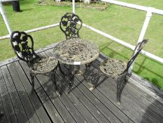 Cast Iron Table with Three Chairs