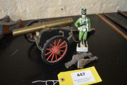 Two Small Model Cannon and a China Figurine of a Rifle Brigade Officer